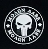 """Photo close-up of decal showing a white skull design inside two concentric circles with the words """"Molon Labe"""" repeated twice."""